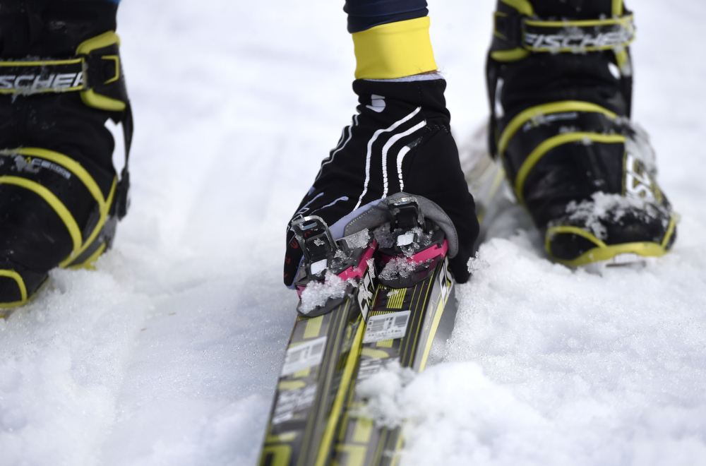 . An athlete picks up her skis during the Women\'s Cross-Country Skiing Individual Sprint Free Quarterfinals at the Laura Cross-Country Ski and Biathlon Center during the Sochi Winter Olympics on February 11, 2014 in Rosa Khutor near Sochi. (ODD ANDERSEN/AFP/Getty Images)