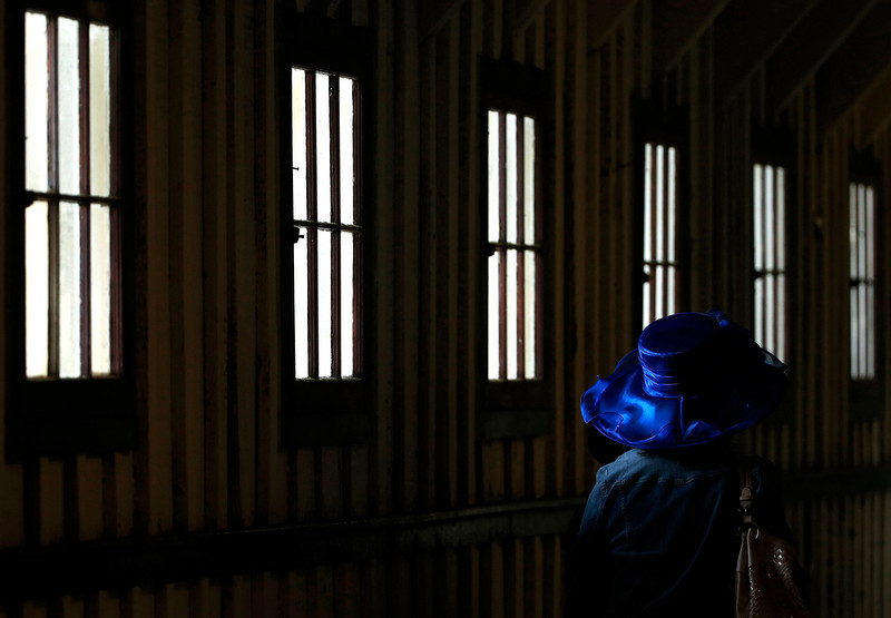 . A racing fan heads to the track before the 139th Preakness Stakes horse race at Pimlico Race Course, Saturday, May 17, 2014, in Baltimore.   (AP Photo/Matt Slocum)