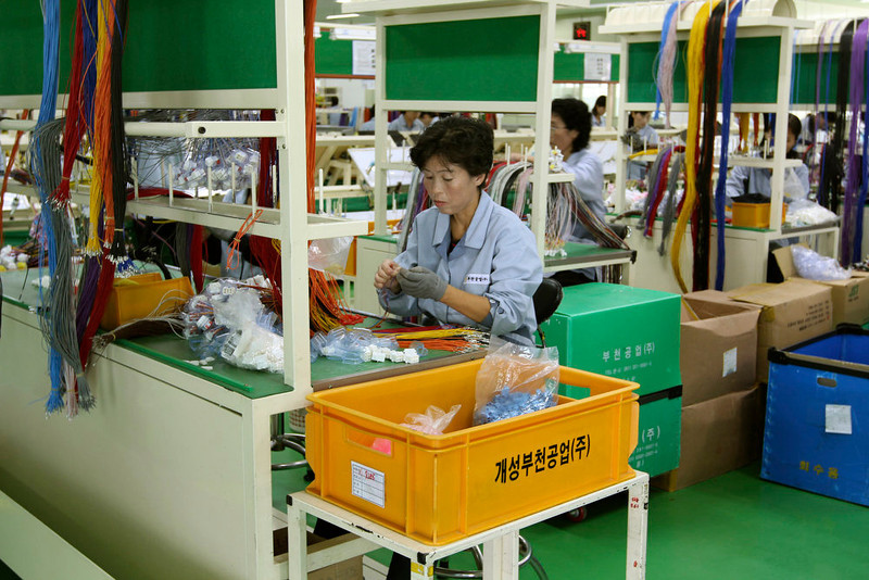 . In this Sept. 21, 2012 photo, a North Korean worker handles wires at a South Korean-run factory inside the Kaesong industrial complex in Kaesong, North Korea. On Wednesday, April 3, 2013, North Korea refused entry to South Koreans trying to cross the Demilitarized Zone to get to their jobs managing factories in the North Korean city of Kaesong. Pyongyang had threatened in recent days to close the border in anger over South Korea\'s support of U.N. sanctions punishing North Korea for conducting a nuclear test in February. (AP Photo/Jean H. Lee)