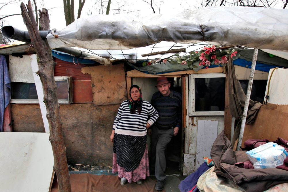 . Roma woman Magdalena and her husband Trean pose for a portrait outside their shelter in an illegal camp in Lille, northern France on International Roma Day on April 8, 2013.   REUTERS/Pascal Rossignol