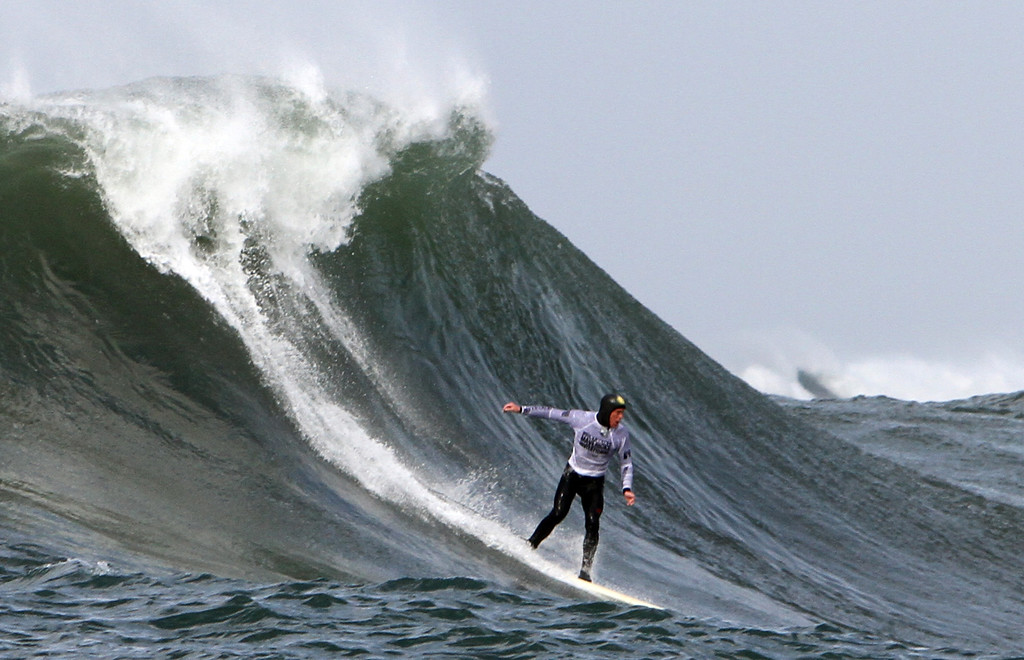 . Ryan Augenstein finishes his run during the second semifinal heat during the Mavericks Invitational competition in Half Moon Bay on Friday. (Kevin Johnson/Sentinel)