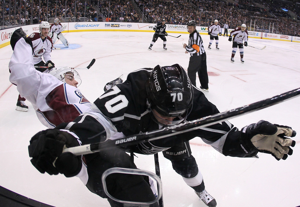 . LOS ANGELES, CA - NOVEMBER 23:  Tanner Pearson #70 of the Los Angeles Kings checks Tyson Barrie #4 of the Colorado Avalanche in the second period during the NHL game at Staples Center on November 23, 2013 in Los Angeles, California.  (Photo by Victor Decolongon/Getty Images)