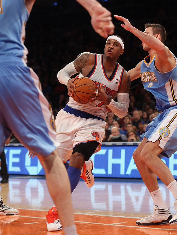 . Carmelo Anthony #7 of the New York Knicks drives the basket late in the fourth quarter against the Denver Nuggets at Madison Square Garden on December 9, 2012 in New York City. The Knicks defeated the Nuggets 112-106. (Photo by Bruce Bennett/Getty Images)