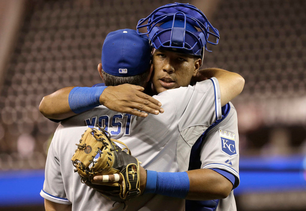 . Kansas City Royals manager Ned Yost and catcher Salvador Perez celebrate after the Royals beat the Minnesota Twins 8-1 on Wednesday in Minneapolis. Perez hit two, two-run home runs in the game. (AP Photo/Jim Mone)