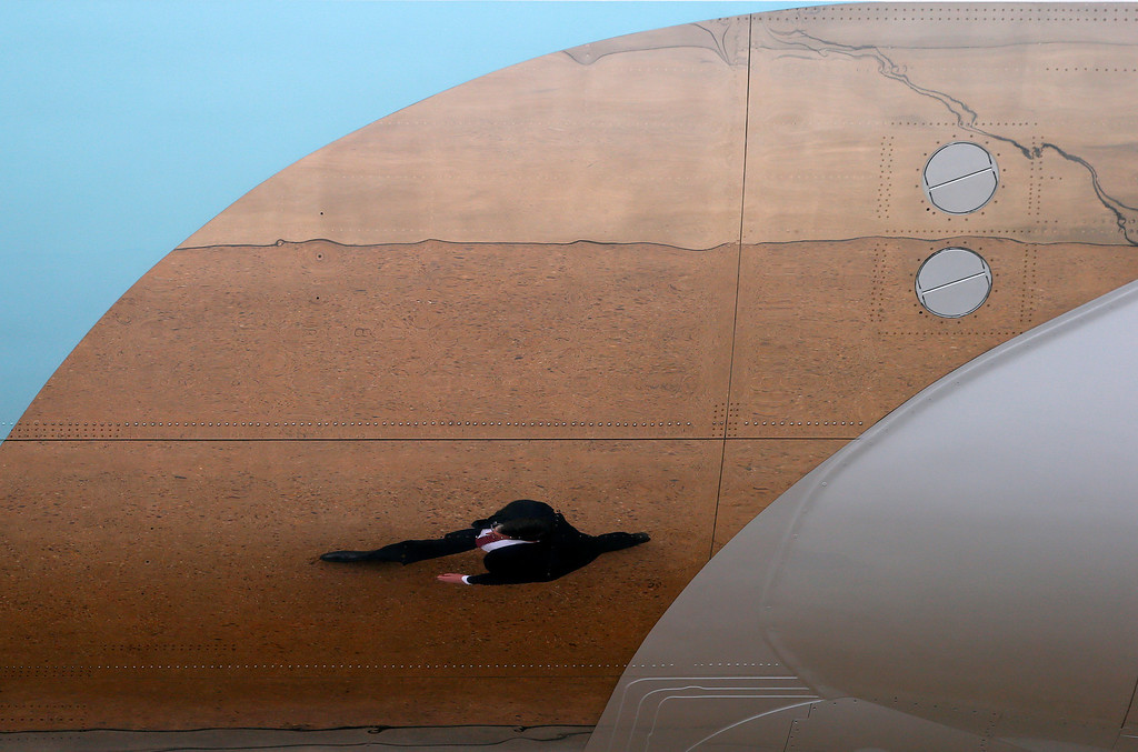 . A member of the Secret Service is reflected in the side of Air Force One at McGuire Air Force Base, N..J. Tuesday, May 28, 2013. President Barack Obama and New .Jersey Gov.  (AP Photo/Rich Schultz)