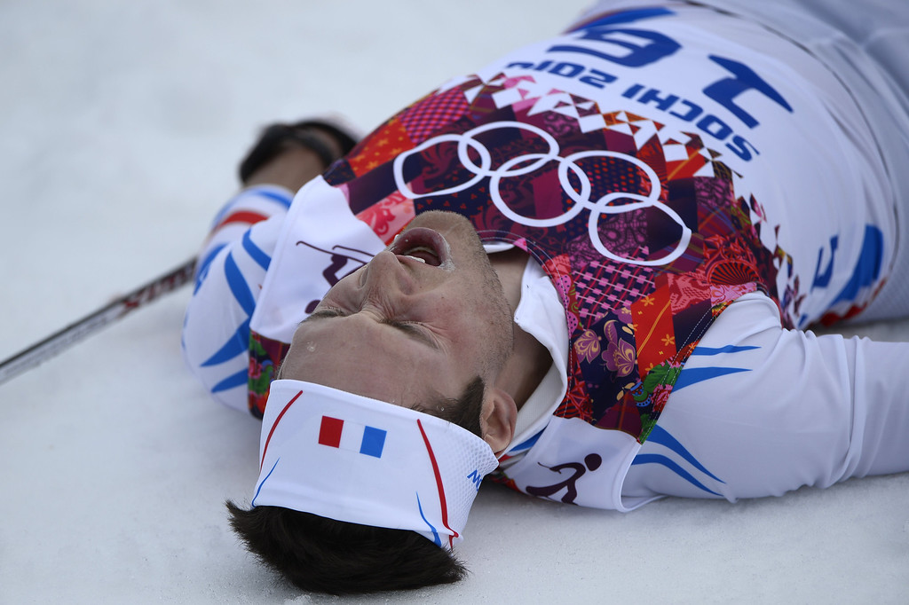. France\'s Adrien Backscheider crosses the finish line in the Men\'s Cross-Country Skiing 15km Classic at the Laura Cross-Country Ski and Biathlon Center during the Sochi Winter Olympics on February 14, 2014 in Rosa Khutor near Sochi.  AFP PHOTO / PIERRE-PHILIPPE MARCOU/AFP/Getty Images