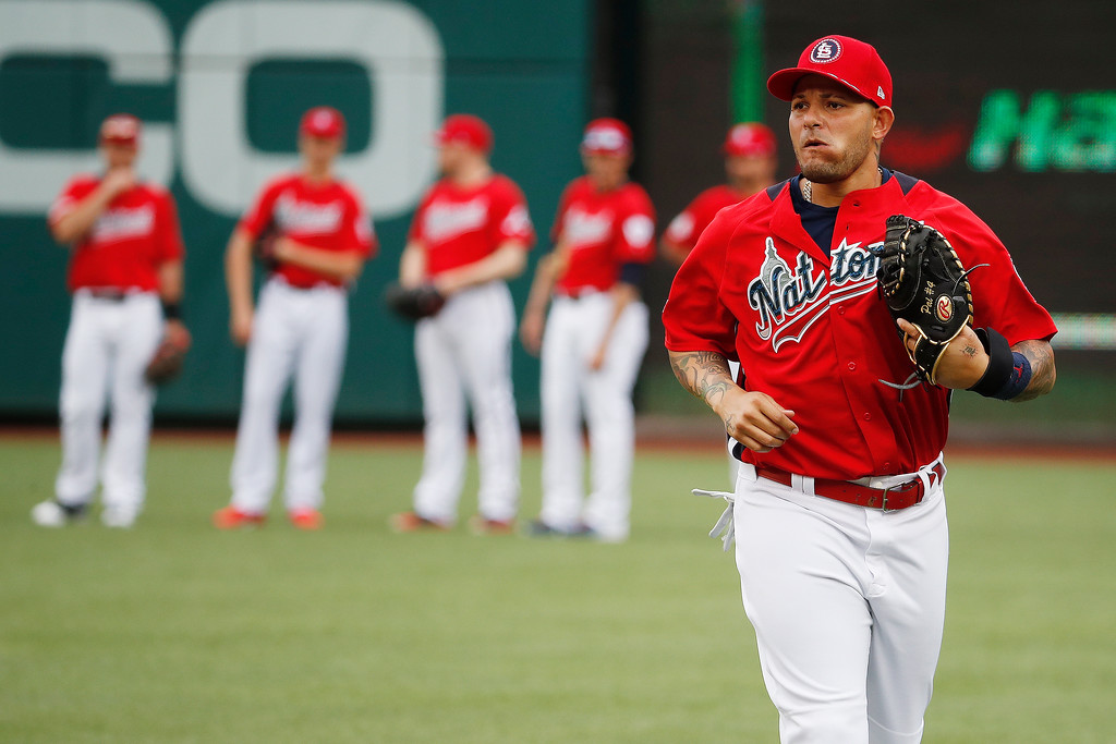 . National League, St. Louis Cardinals Yadier Molina (4) runs across the field ahead of the 89th MLB baseball All-Star Game, Tuesday, July 17, 2018, at Nationals Park, in Washington. (AP Photo/Alex Brandon)