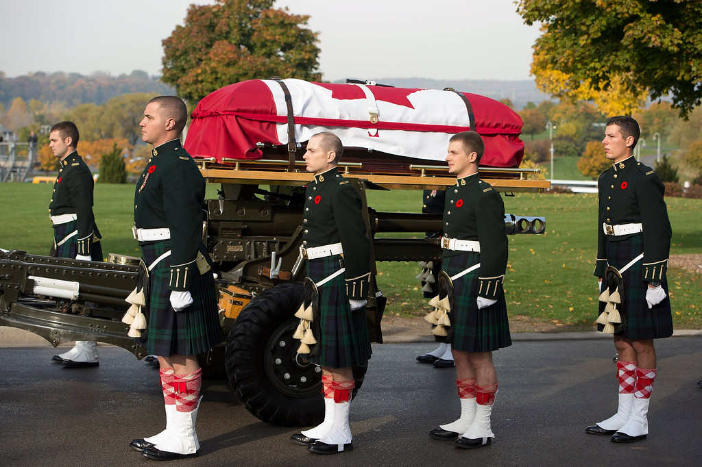 . The casket of Cpl. Nathan Cirillo is towed during his funeral procession in Hamilton, Ontario,  on Tuesday, Oct. 28, 2014. Cirillo was standing guard at the National War Memorial in Ottawa last Wednesday when he was killed by a gunman who went on to open fire on Parliament Hill before being shot down in a hail of bullets. Cirillo will be laid to rest in his southern Ontario hometown.   (AP Photo/The Canadian Press, Frank Gunn)