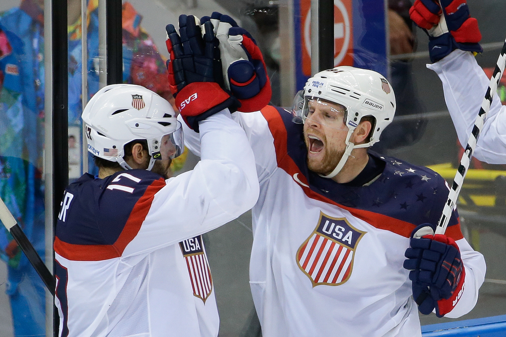 . USA forward Phil Kessel, right, reacts to his goal with teammate Ryan Kesler during the third period of men\'s quarterfinal hockey game against the Czech Republic in Shayba Arena at the 2014 Winter Olympics, Wednesday, Feb. 19, 2014, in Sochi, Russia. (AP Photo/Matt Slocum)