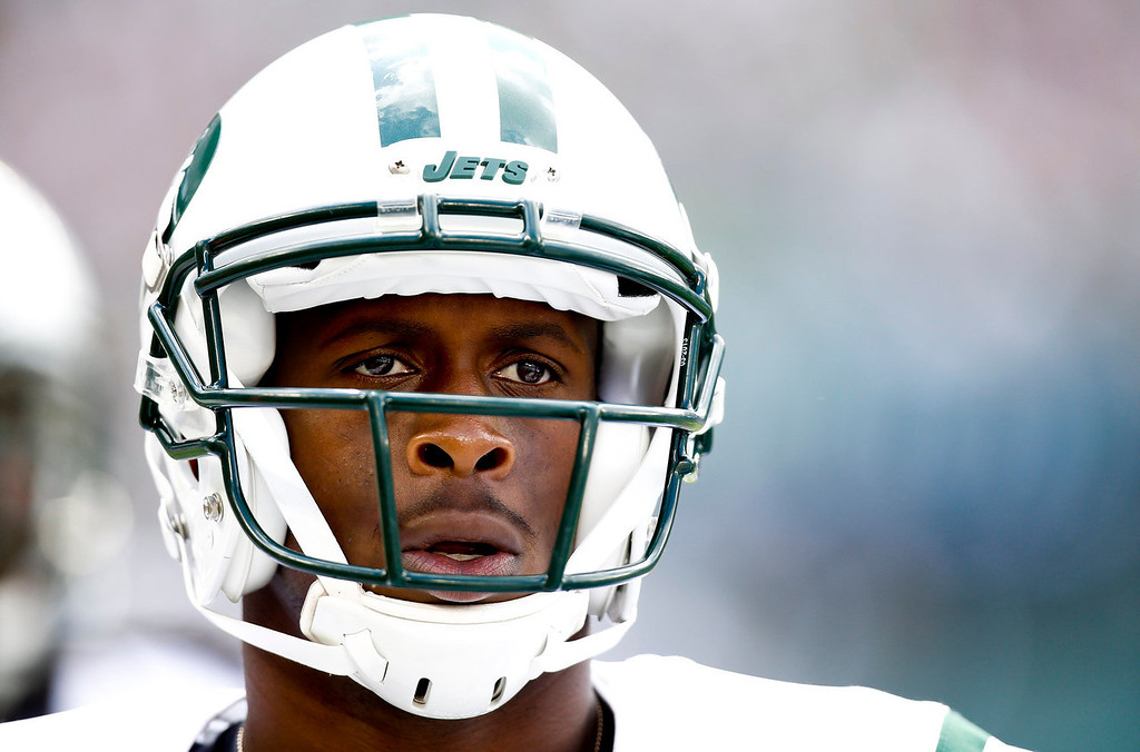 . Geno Smith #7 of the New York Jets walks to the sidelines during their game against the Tampa Bay Buccaneers at MetLife Stadium on September 8, 2013 in East Rutherford, New Jersey.  (Photo by Jeff Zelevansky/Getty Images)