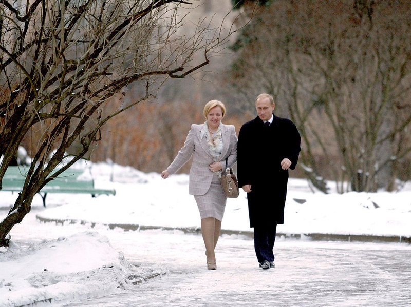 . Russia\'s President Vladimir Putin (R) and his wife, Lyudmila, approach a polling station in Moscow in this December 7, 2003 file photograph. Putin and his wife, Lyudmila, said on state television on Thursday that they had separated and their marriage was over after 30 years. REUTERS/Viktor Korotayev/Files