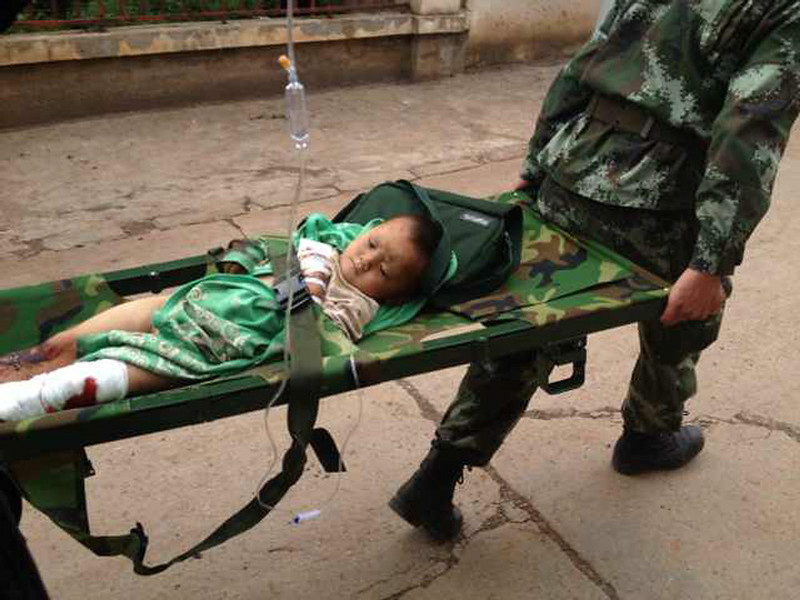 . Rescuers carry an injured child on a stretcher after a 6.1 magnitude earthquake hit the area in Ludian county in Zhaotong, southwest China\'s Yunnan province on August 3, 2014.  The quake struck 11 kilometres (seven miles) west-northwest of the town of Wenping at a relatively shallow depth of 10 kilometres at 4:30 pm (0830 GMT).    STR/AFP/Getty Images