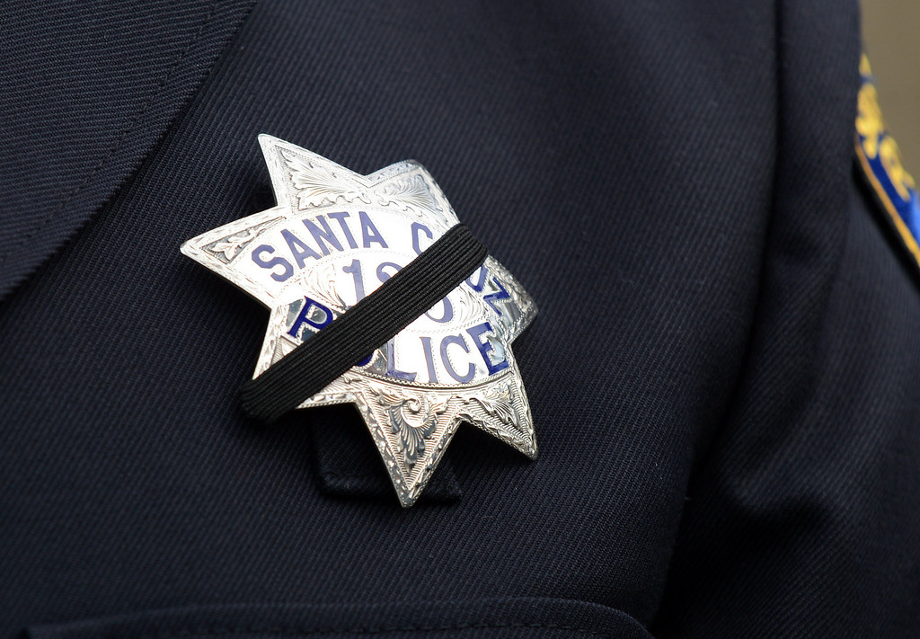 . A Santa Cruz officer\'s badge is covered with a black stripe at HP Pavilion in San Jose, Calif., on Thursday, March 7, 2013. (Dan Honda/Bay Area News Group)