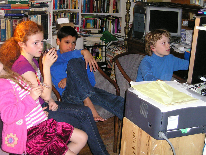 Alex's friends watch him play computer games. I don't get the appeal, but whatever.