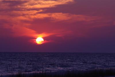 Sun Setting & Moon Rising