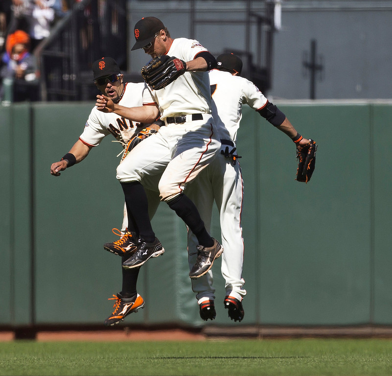 . (R-L) Gregor Blanco #7 of the San Francisco Giants, Hunter Pence #8, and Andres Torres #56 celebrate in the outfield after the game against the Colorado Rockies at AT&T Park on May 26, 2013 in San Francisco, California. The San Francisco Giants defeated the Colorado Rockies 7-3. (Photo by Jason O. Watson/Getty Images)