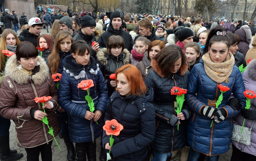 . Girls hold fake flowers as they take part in a silent march in the western Ukrainian city of Lviv on February 19, 2015, marking the first anniversary of killings during anti-government protests on and around Independance Square in Kiev, known as Maidan. Violent clashes in Kiev one year ago left nearly 100 dead, including more than 50 protesters shot dead on Institutska street on February 20, 2014, the bloodiest day, and set in motion a series of dizzying changes in Ukraine that culminated in parliament voting to oust Yanukovych and free the steely former prime minister Yulia Tymoshenko.   AFP PHOTO/ YURKO DYACHYSHYNYURKO DYACHYSHYN/AFP/Getty Images