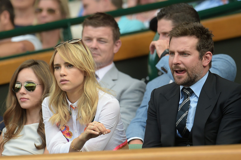. US actor Bradley Cooper and his girlfriend British model Suki Waterhouse sit in the Royal box on Centre Court as they watch the men\'s singles semi-final match between Switzerland\'s Roger Federer and Canada\'s Milos Raonic during their on day 11 of the 2014 Wimbledon Championships at The All England Tennis Club in Wimbledon, southwest London, on July 4, 2014. (FACUNDO ARRIZABALAGA/AFP/Getty Images)