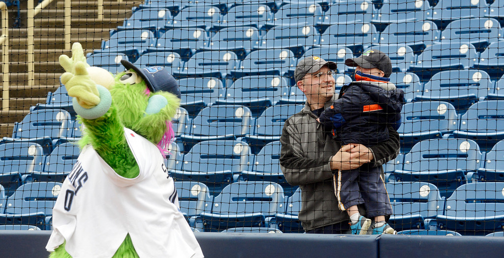 . Maribeth Joeright/MJoeright@News-Herald.com<p> Robert Guttu of Mentor and his son Brody, 2, enjoy watching the antics of Captains mascot Skipper before the start of the home opener against Lansing, April 4, 2014.
