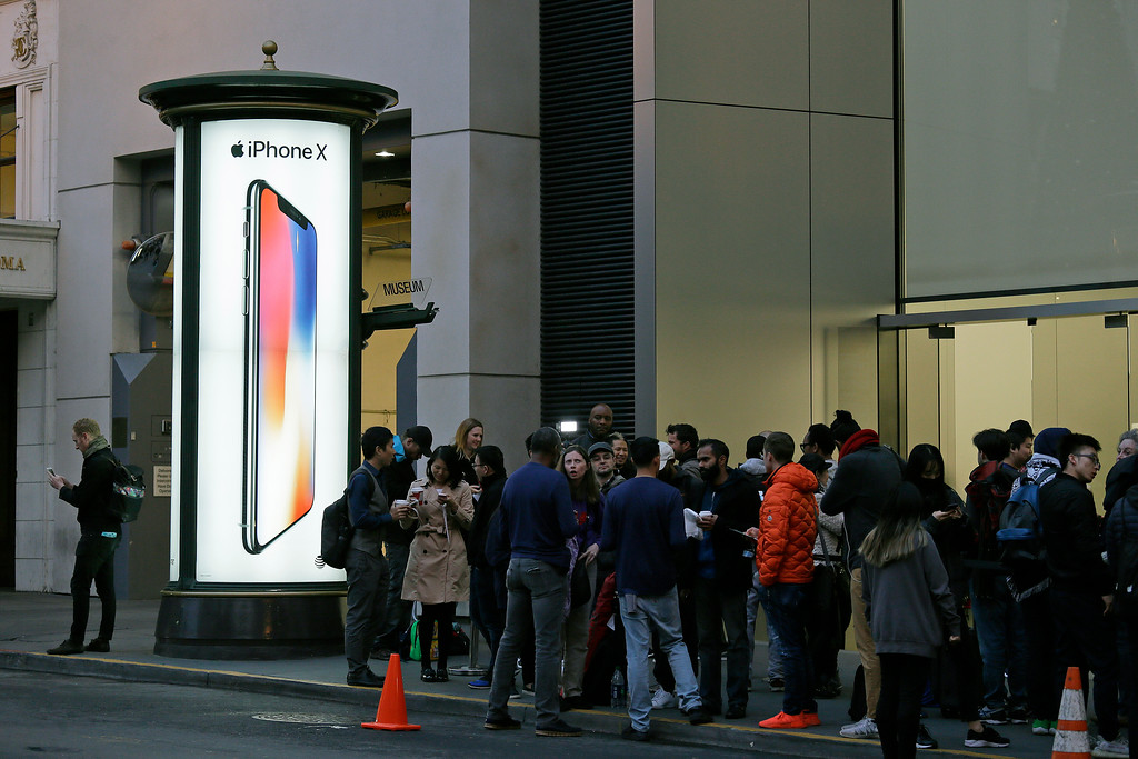 . People stand in line outside the Apple Union Square store to purchase the new iPhone X Friday, Nov. 3, 2017, in San Francisco. (AP Photo/Eric Risberg)