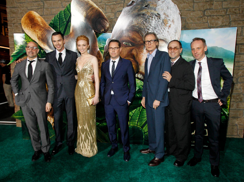 """Description of . Director Bryan Singer (C) poses with cast members (from L-R) Stanley Tucci, Nicholas Hoult, Eleanor Tomlinson, Bill Nighy, John Kassir and Ewen Bremner at the premiere of \""""Jack the Giant Slayer\"""" in Hollywood, California February 26, 2013. The movie opens in the U.S. on March 1.  REUTERS/Mario Anzuoni"""