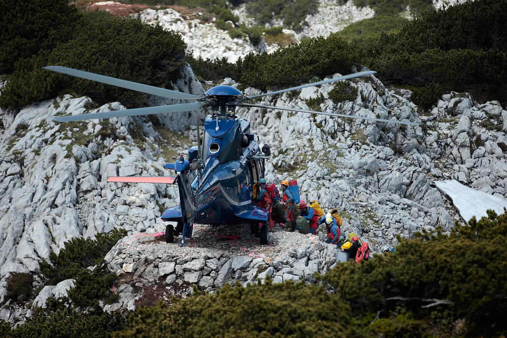 . Rescue workers step into an police helicopter near the entrance to the Riesending vertical cave during the final phase of the transport of injured spelunker Johann Westhauser to the surface on June 19, 2014 near Marktschellenberg, Germany.  (Photo by Johannes Simon/Getty Images)