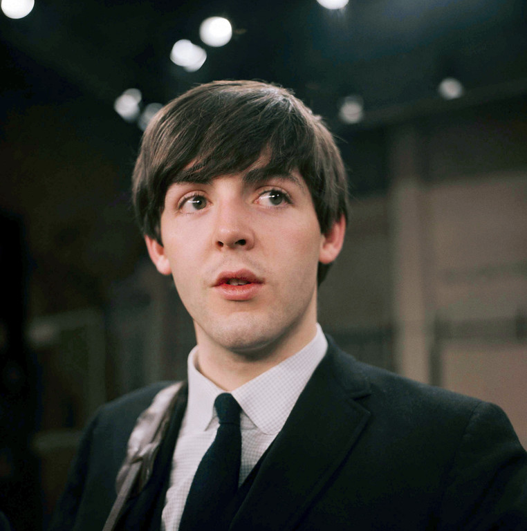 . Paul McCartney, bassist for the Beatles, is shown on the set of the Ed Sullivan Show, Feb. 1964. (AP Photo)