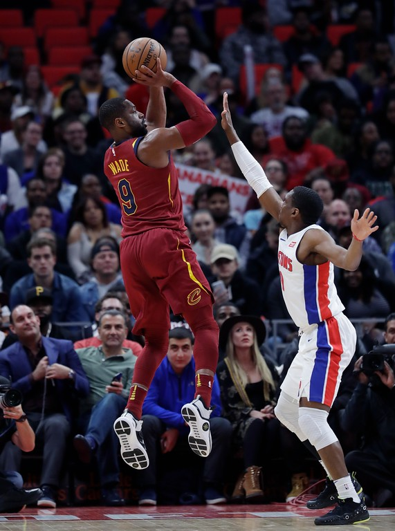 . Cleveland Cavaliers guard Dwyane Wade (9) shoots over Detroit Pistons guard Langston Galloway during the first half of an NBA basketball game, Monday, Nov. 20, 2017, in Detroit. (AP Photo/Carlos Osorio)