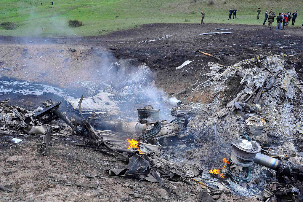 . The wreckage of the Boeing KC-135 Stratotanker plane is seen at the site of the crash near the Kyrgyz village of Chaldovar, May 3, 2013. A U.S. military refuelling plane on its way to Afghanistan exploded in mid air and crashed in Kyrgyzstan on Friday when its cargo of fuel ignited, the Central Asian country\'s Emergencies Ministry said. The aircraft took off from the U.S. military transit centre at Kyrgyzstan\'s international Manas airport, which U.S. forces maintain for operations in Afghanistan, with around 70 tonnes of fuel on board, a local ministry official said. REUTERS/Sabyr Alichiev/Pool