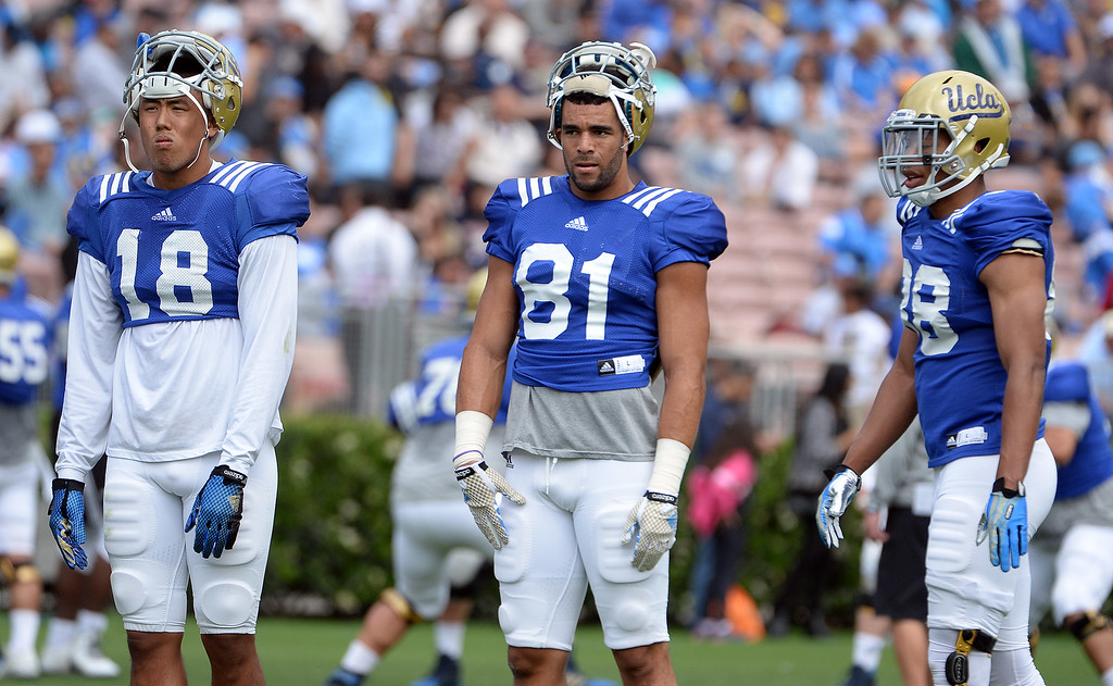 . UCLA Bruins wide receiver Thomas Duarte (18) with wide receiver Tyler Scott (81) during a NCAA college spring football game at the Rose Bowl in Pasadena, Calif., Saturday, April 25, 2015.