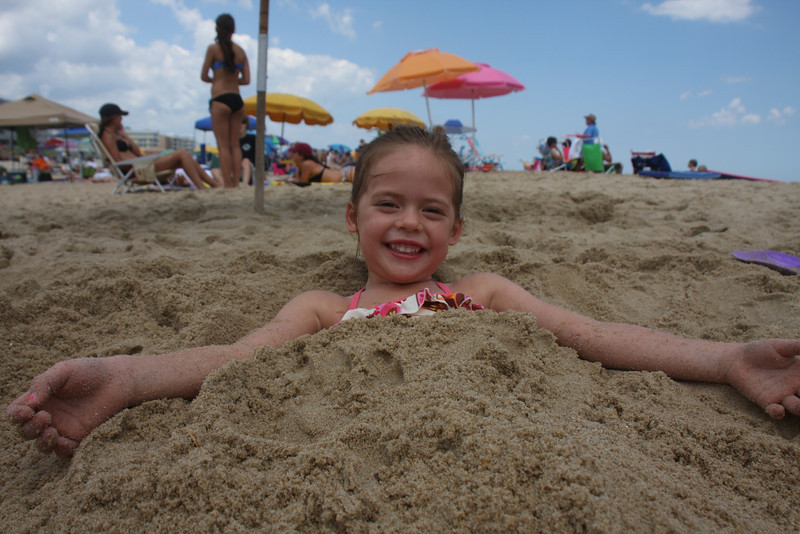 And, the beach trip wouldn't be complete without someone getting buried....