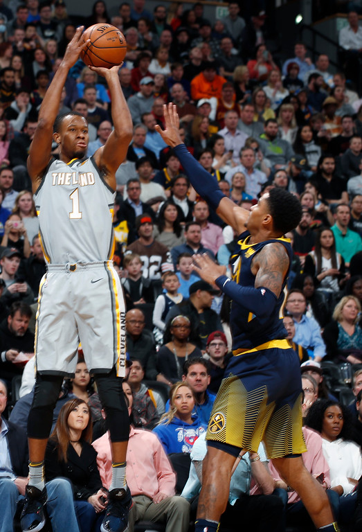 . Cleveland Cavaliers guard Rodney Hood shoots over Denver Nuggets guard Gary Harris during the first half of an NBA basketball game Wednesday, March 7, 2018, in Denver. (AP Photo/David Zalubowski)