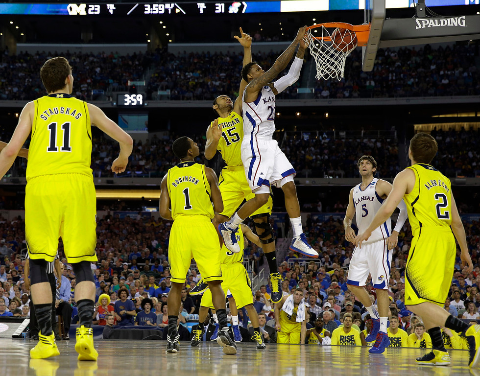 . Kansas\' Ben McLemore dunks during the first half of a regional semifinal game against Michigan in the NCAA college basketball tournament, Friday, March 29, 2013, in Arlington, Texas. (AP Photo/David J. Phillip)