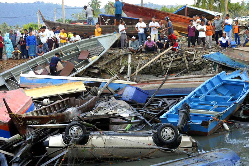 . Fishing boats and a car among the debris along the coast of Langkawi island, northwest Malaysia, after a tidal wave was triggered by a massive 9.0 magnitude earthquake on the nearby Indonesian island of Sumatra on December 26, 2004. More than 11,400 people were killed and thousands more were missing after the quake and resulting tidal waves wreaked havoc across southern Asia.  AFP/AFP/Getty Images