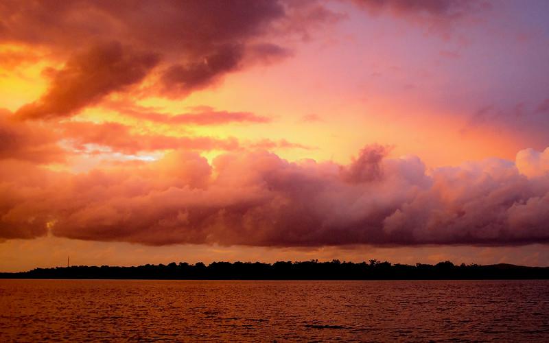 Pink colored cumulus cloud, sunset seascape.