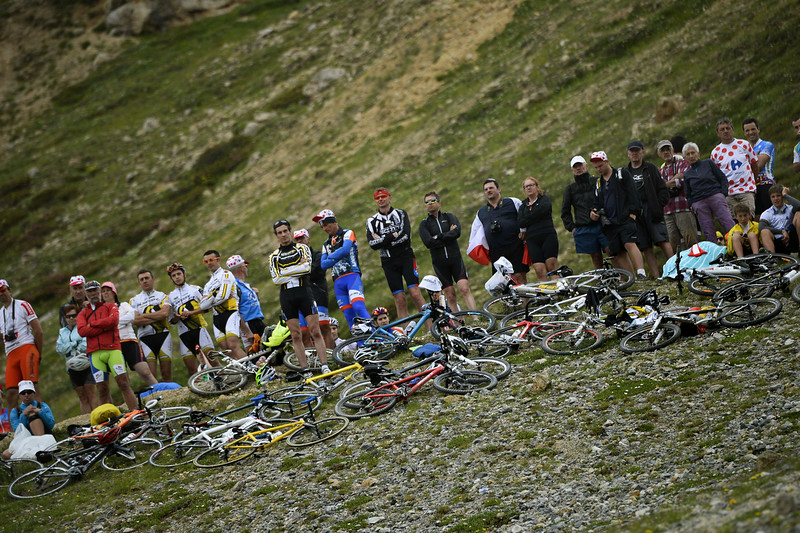 . Supporters with bikes stand along the road during the 177 km fourteenth stage of the 101st edition of the Tour de France cycling race on July 19, 2014 between Grenoble and Risoul, eastern France. (LIONEL BONAVENTURE/AFP/Getty Images)