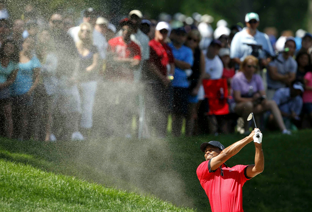 . Tiger Woods of the U.S. hits his second shot on the second hole from the sand during the final round of the WGC-Bridgestone Invitational golf tournament in Akron, Ohio, August 4, 2013.  REUTERS/Matt Sullivan