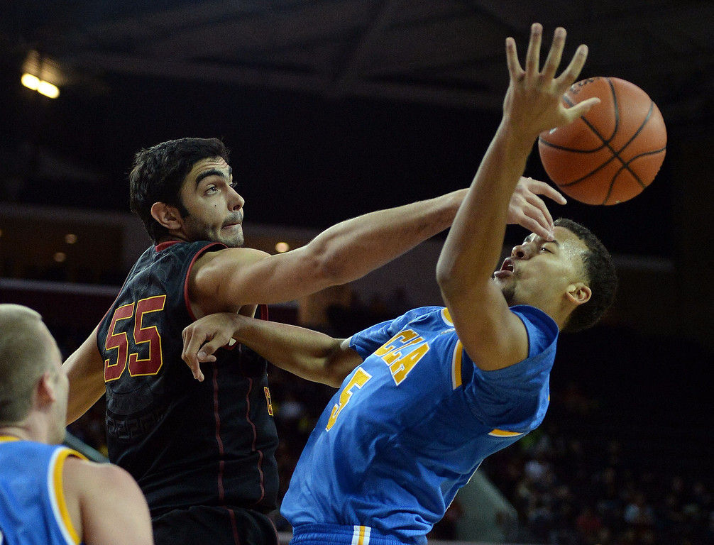 . Southern California\'s Omar Oraby (55) blocks the shot by UCLA\'s Kyle Anderson (5) in the first half of a PAC-12 NCAA basketball game at Galen Center in Los Angeles, Calif., on Saturday, Feb. 8, 2014. (Keith Birmingham Pasadena Star-News)