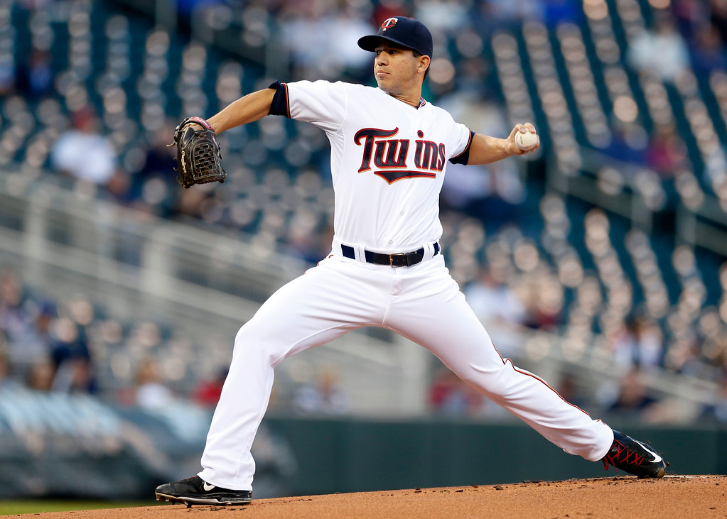 . Minnesota Twins pitcher Tommy Milone throws against the Detroit Tigers in the first inning of a baseball game, Monday, April 27, 2015, in Minneapolis. (AP Photo/Jim Mone)