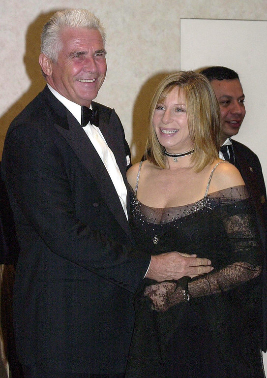 . US singer/actress/director Barbra Streisand (R) hugs her husband James Brolin (L) after receiving the American Film Institute\'s Life Achievement Award backstage before a gala tribute dinner in Beverly Hills, 22 February 2001. (LUCY NICHOLSON/AFP/Getty Images)