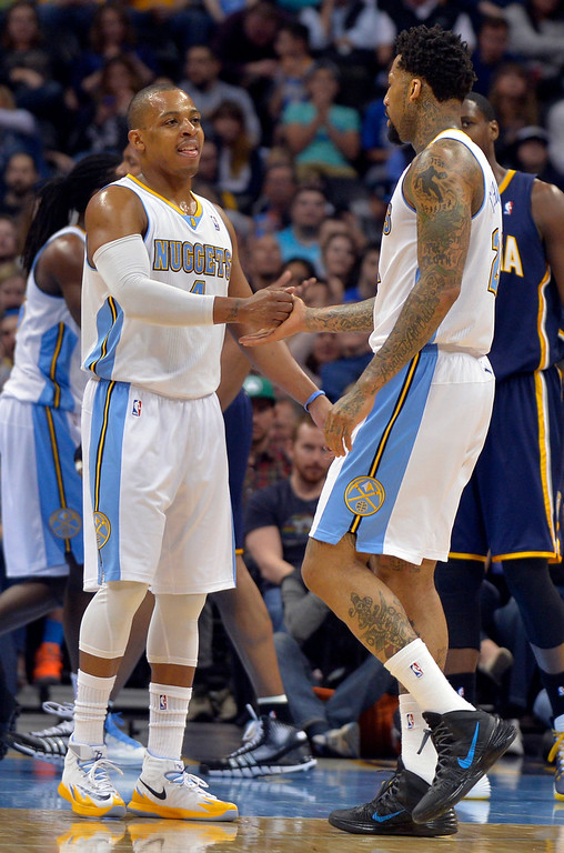 . Denver Nuggets guard Randy Foye, left, congratulates Wilson Chandler (21) after Chandler drew a foul during the third quarter of an NBA basketball game against the Indiana Pacers on Saturday, Jan. 25, 2014, in Denver. Denver defeated Indiana 109-96. (AP Photo/Jack Dempsey)
