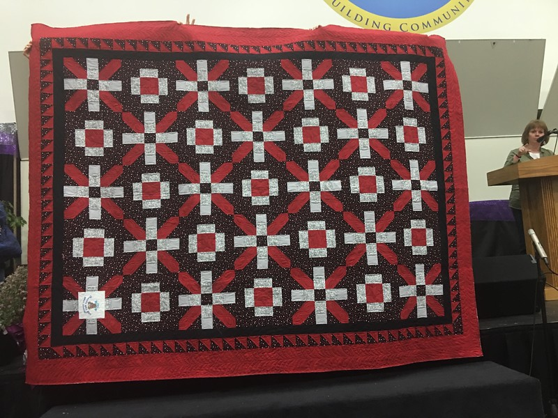 Debbie Feldpausch.  this quilt is made from blocks from the Chocolatiers.  A small group doing a block exchange.  Quilted by Mary Hausauer.  It is being donated to Morgan's House for disabled veterans.