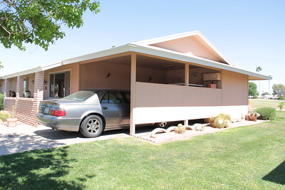 CARPORT CONVERSION INTO A GARAGE