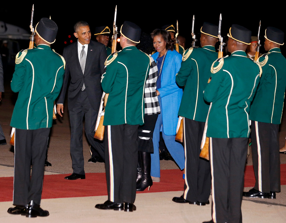 . U.S. President Barack Obama and first lady Michelle Obama arrive at Waterkloof Air Base in South Africa, June 28, 2013.   REUTERS/Jason Reed