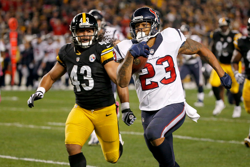 . Houston Texans running back Arian Foster (23) runs past Pittsburgh Steelers strong safety Troy Polamalu (43) in the first quarter of the NFL football game against the Pittsburgh Steelers, Monday, Oct. 20, 2014, in Pittsburgh. (AP Photo/Gene J. Puskar)