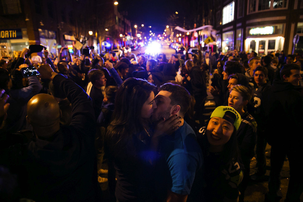 . Sofia Locklear and Patrick Berg share a moment together as fans take to the street  in the Capitol Hill neighborhood of Seattle as they celebrate the Seattle Seahawks winning  Superbowl XLVIII game, on Sunday, Feb. 2, 2014.  (AP Photo/The Seattle Times, Marcus Yam)