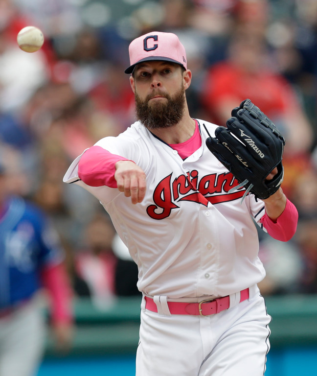 . Cleveland Indians starting pitcher Corey Kluber throws out Kansas City Royals\' Jorge Soler at first base in the seventh inning of a baseball game, Sunday, May 13, 2018, in Cleveland. (AP Photo/Tony Dejak)