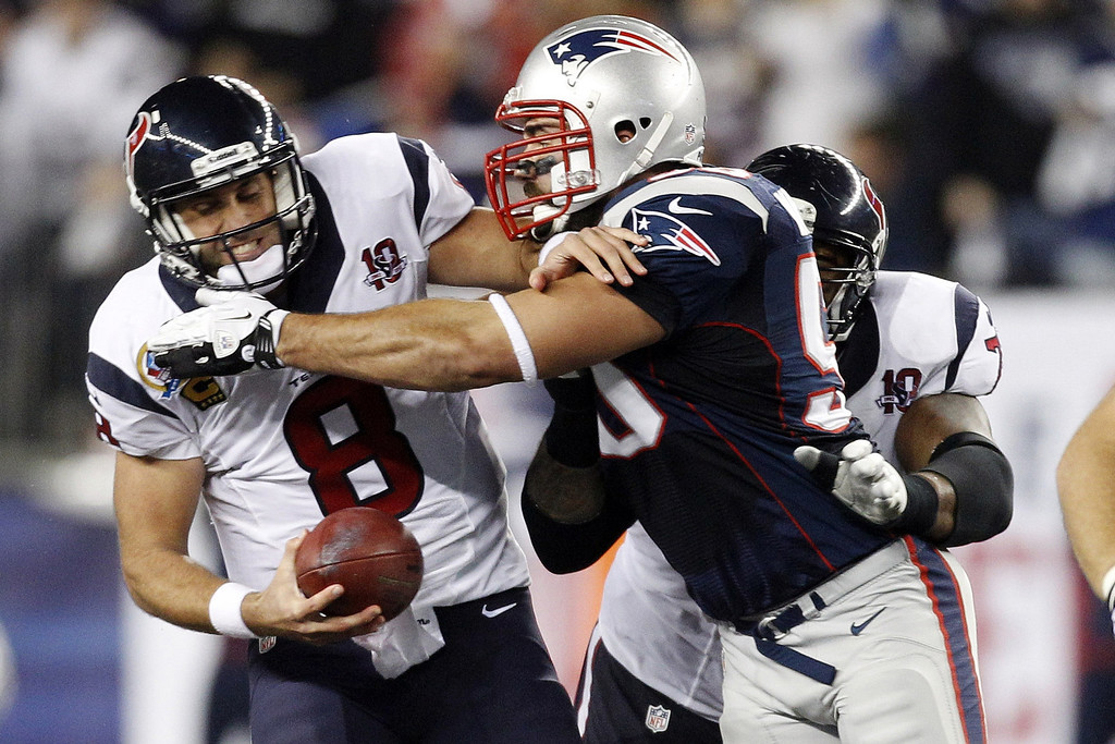 . Houston Texans quarterback Matt Schaub (8) is sacked by New England Patriots defensive end Rob Ninkovich (50) during the first quarter of an NFL football game in Foxborough, Mass., Monday, Dec. 10, 2012. (AP Photo/Stephan Savoia)
