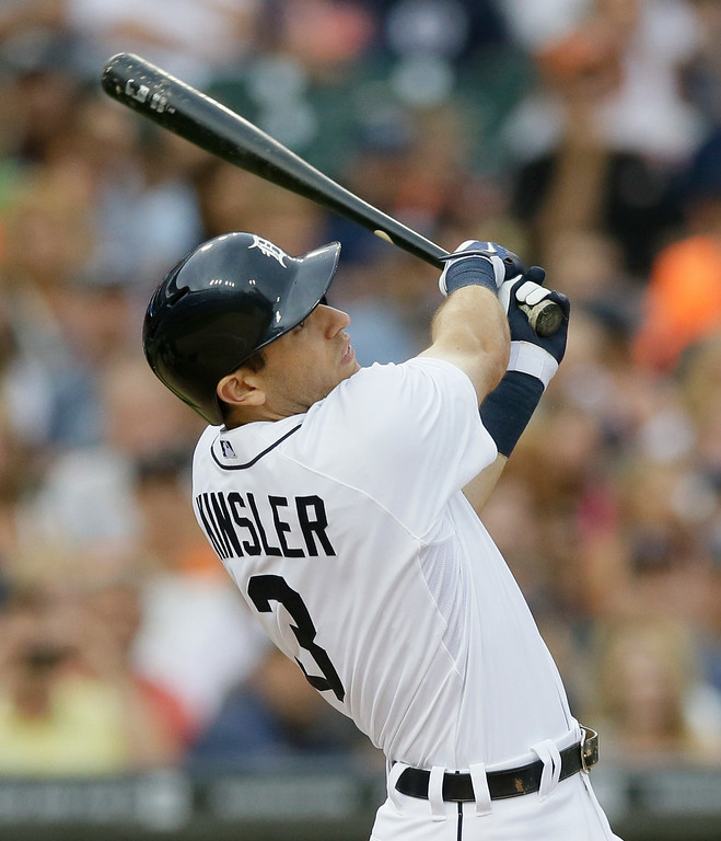 . Detroit Tigers\' Ian Kinsler hits a sacrifice fly off Cleveland Indians starting pitcher Trevor Bauer during the third inning of a baseball game in Detroit, Friday, July 18, 2014. (AP Photo/Carlos Osorio)