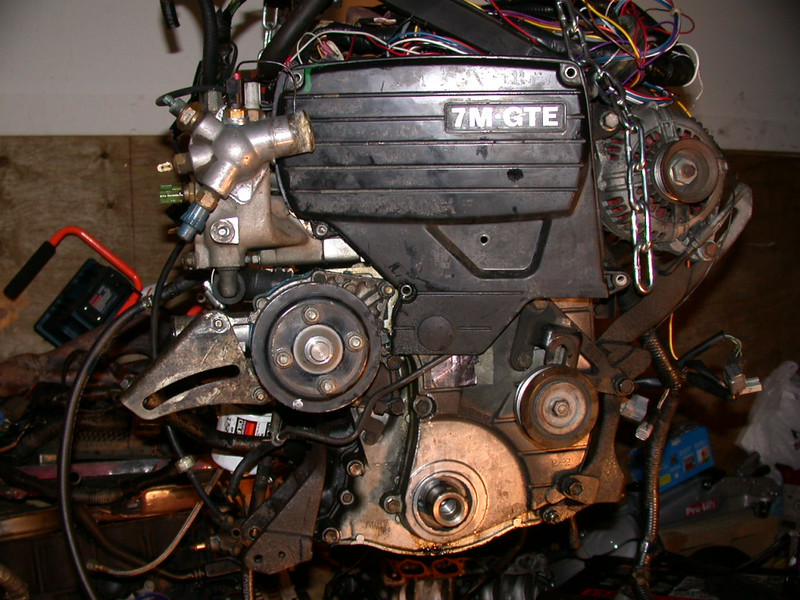 begin removing accessories from the old engine